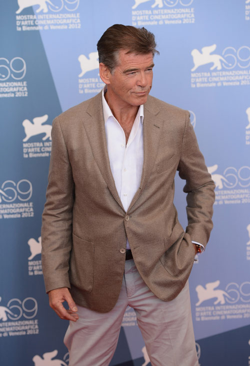 "<div class=""meta ""><span class=""caption-text "">Pierce Brosnan (second from right), wearing a suit and a Squadra Rose Gold Jaeger-LeCoultre watch, attends the photo call for 'Love Is All You Need' at the Venice Film Festival in Italy on Sept. 2, 2012. (Ian Gavan/Getty Images for Jaeger-LeCoultre)</span></div>"