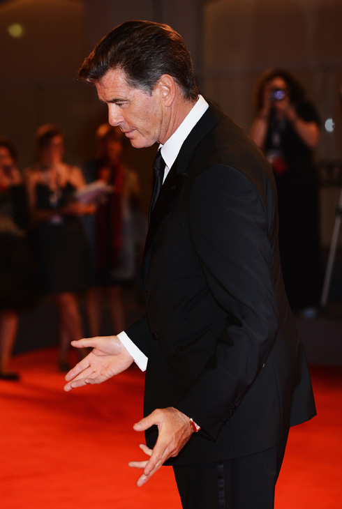 Pierce Brosnan, wearing a suit and a Squadra Rose Gold Jaeger-LeCoultre watch, attends th