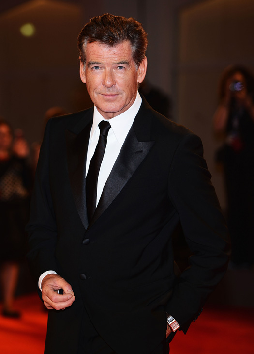 Pierce Brosnan, wearing a suit and a Squadra Rose Gold Jaeger-LeCoultre watch, attends the premiere