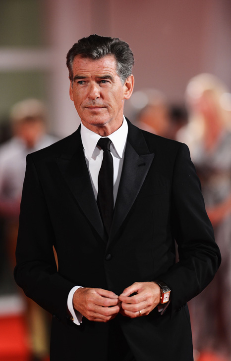 Pierce Brosnan, wearing a suit and a Squadra Rose Gold Jae