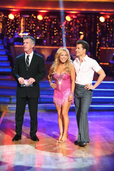 Emmy-winning co-host Tom Bergeron stands beside Sabrina Bryan as she stands with her partner Louis Van Amstel. They received