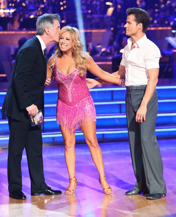 Emmy-winning co-host Tom Bergeron kisses Disney Channel actress Sabrina Bryan as she stands with her partner Louis Van Amstel. They received 22.5 out of 30 points from the judges for their Cha Cha Cha on the season premiere of &#39;Dancing With The Stars: All-Stars,&#39; which aired on September 24, 2012.  <span class=meta>(ABC &#47; Adam Taylor)</span>