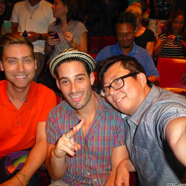 Lance Bass, fiance Michael Turchin and a fan appear at a Backstreet Boys concert at the Gibson Amphitheatre in the Universal City area of Los Angeles on Sept. 4, 2013.