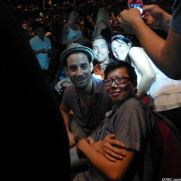 Lance Bass, fiance Michael Turchin and a fan pose for photos at a Backstreet Boys concert at the Gibson Amphitheatre in the Universal City area of Los Angeles on Sept. 4, 2013.
