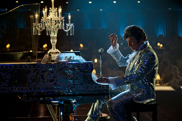 "<div class=""meta image-caption""><div class=""origin-logo origin-image ""><span></span></div><span class=""caption-text"">Michael Douglas appears as Liberace in the HBO film 'Behind the Candelabra.' The movie premiered on May 26, 2013 and depicts the life of the pianist and his 6-year relationship with lover Scott Thorson, played by Matt Damon. (Claudette Barius / HBO)</span></div>"