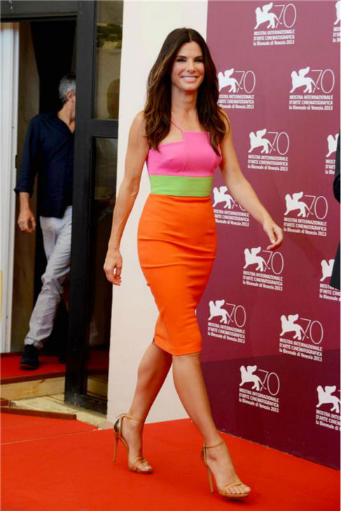 Sandra Bullock walks the red carpet at a photo call for the film &#39;Gravity&#39; at the 70th annual Venice International Film Festival on Aug. 27, 2013. She is wearing a bright pink, green and orange color block Alex Perry Resort 2014 dress, featuring a pencil skirt, and nude Giuseppe Zanotti stiletto sandals. <span class=meta>(Comi &#47; Terenghi &#47; Startraksphoto.com)</span>