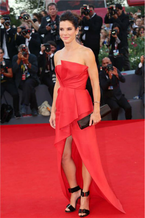 Sandra Bullock walks the red carpet at the premiere of the film &#39;Gravity&#39; at the 70th annual Venice International Film Festival on Aug. 28, 2013. She is wearing a red, silk, strapless J. Mendel Resort 2014 &#39;Siren&#39; gown. <span class=meta>(Comi &#47; Terenghi &#47; Startraksphoto.com)</span>