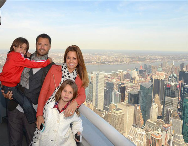 Brooke Burke-Charvet, husband David Charvet and daughters Rain and Shaya appear at the top of the Empire State Building in New York on April 25, 2014. <span class=meta>(Michael Simon &#47; Startraksphoto.com)</span>