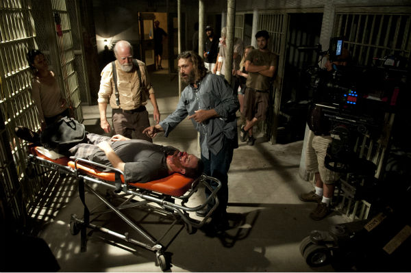 "<div class=""meta ""><span class=""caption-text "">Sonequa Martin-Green (Sasha), Director David Boyd and Scott Wilson (Hershel Greene) appear on the set of AMC's 'The Walking Dead' while filming episode 5 of season 4, titled 'Internment,' which aired on Nov. 10, 2013. (Gene Page / AMC)</span></div>"