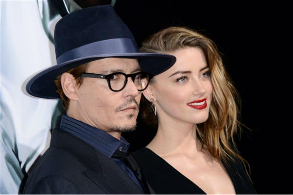 "<div class=""meta image-caption""><div class=""origin-logo origin-image ""><span></span></div><span class=""caption-text"">Johnny Depp and reported fiancee Amber Heard, who wore a diamond ring, appear at the premiere of the movie '3 Days To Kill' in Los Angeles on Feb. 12, 2014. It was reported in January that the two are engaged, although the pair has not confirmed this. (Lionel Hahn / Abacausa / Startraksphoto.com)</span></div>"