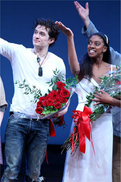 Orlando Bloom appears with co-star Condola Rashad on stage at the opening night of the play 'Romeo and Juliet,' which marks the actor's Broadway debut, in New York on Sept. 19, 2013.