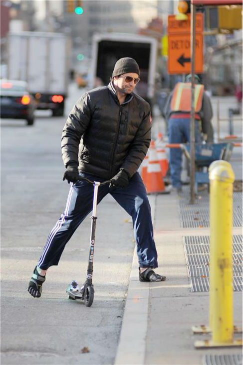 Hugh Jackman rides a scooter in New York City on Nov. 20, 2013.