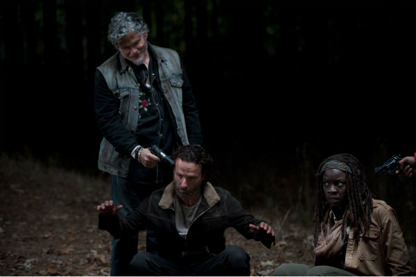 Joe &#40;Jeff Kober&#41; holds a gun to Rick Grimes&#39; &#40;Andrew Lincoln&#41; head in what he says is retaliation for his killing of one of the members of his group, while Michonne &#40;Danai Gurira&#41; plots a move, in this scene from AMC&#39;s &#39;The Walking Dead&#39; season 4 finale, which aired on March 30, 2014. <span class=meta>(Gene Page &#47; AMC)</span>