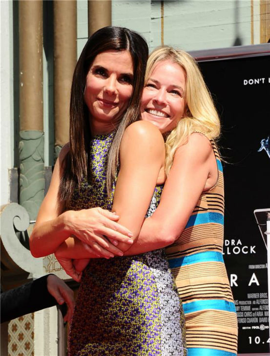 Sandra Bullock poses with talk show host Chelsea Handler at the actress&#39; hand and footprint ceremony at the TCL Chinese Theatre in Hollywood on Sept. 25, 2013. <span class=meta>(Sara De Boer &#47; Startraksphoto.com)</span>