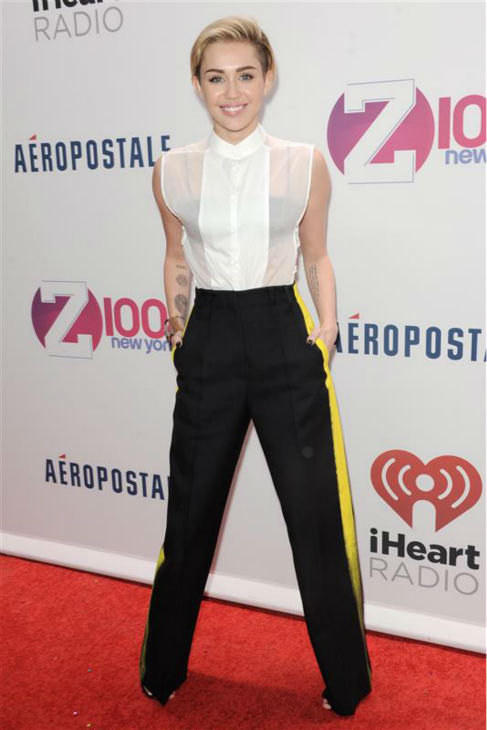 Miley Cyrus walks the red carpet at the 2013 Z100 Jingle Ball at Madison Square Garden in New York on Dec. 13, 2013.