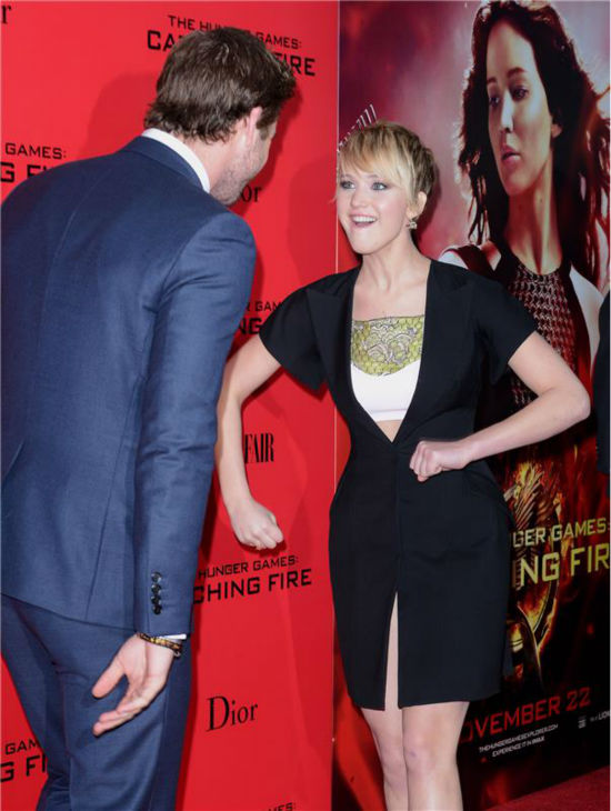 &#39;The Hunger Games: Catching Fire&#39; actress Jennifer Lawrence &#40;Katniss Everdeen&#41; acts goofy in front of co-star Liam Hemsworth &#40;Gale Hawthorne&#41; at the premiere of the movie in New York on Nov. 20, 2013. <span class=meta>(Humberto Carreno &#47; Startraksphoto.com)</span>