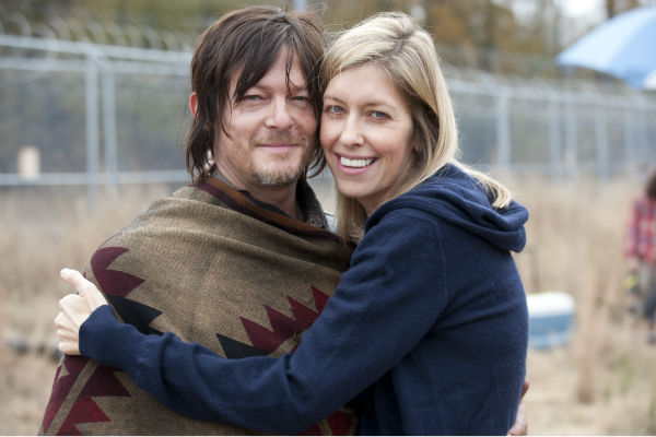 "<div class=""meta ""><span class=""caption-text "">Norman Reedus (Daryl Dixon) and producer Denise Huth appear on the set of AMC's 'The Walking Dead' season 4. The finale aired on March 30, 2014. (Gene Page / AMC)</span></div>"
