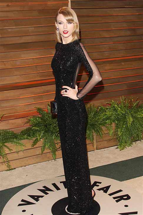 "<div class=""meta image-caption""><div class=""origin-logo origin-image ""><span></span></div><span class=""caption-text"">Taylor Swift appears at the 2014 Vanity Fair Oscar party in Los Angeles on March 2, 2014. (Lionel Hahn / startraksphoto.com)</span></div>"