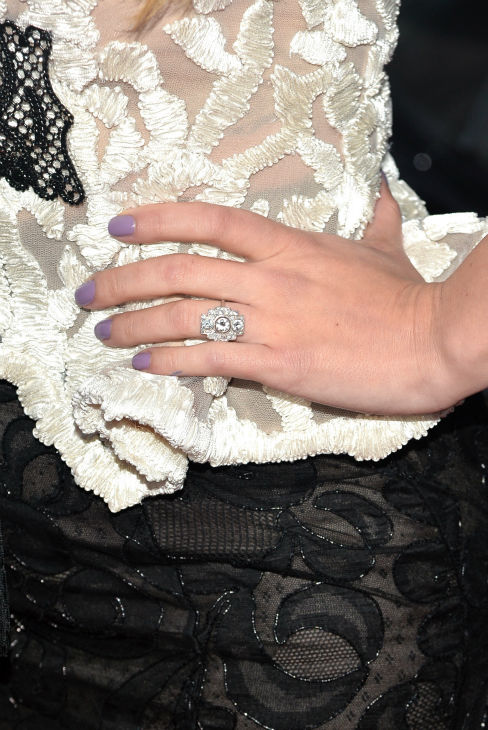 "<div class=""meta ""><span class=""caption-text "">Scarlett Johansson (who is reportedly pregnant) appears wearing her engagement ring at the premiere of Marvel's 'Captain America: The Winter Soldier' at the El Capitan Theatre in Hollywood, California on March 13, 2014. (Alberto E. Rodriguez / Getty Images for Disney)</span></div>"