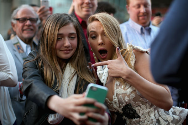 Scarlett Johansson &#40;who is reportedly pregnant&#41; takes a selfie with a fan at the premiere of Marvel&#39;s &#39;Captain America: The Winter Soldier&#39; at the El Capitan Theatre in Hollywood, California on March 13, 2014. <span class=meta>(Christopher Polk &#47; Getty Images for Disney)</span>