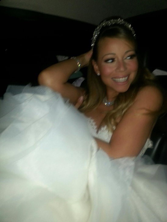 Mariah Carey is seen in a wedding gown inside a vehicle before she and Nick Cannon renewed their vows at Disneyland on April 30, 2013. Accompanied by their twins Moroccan and Monroe, the two celebrated their fifth anniversary as well as the children&#39;s second birthday.  &#39;On our way to renew our vows. I love you @NickCannon shut down Disneyland KKLB,&#39; Carey Tweeted. <span class=meta>(twitter.com&#47;MariahCarey&#47;status&#47;329468868395409408&#47;photo&#47;1 &#47; pic.twitter.com&#47;Xmm4AudJQx)</span>