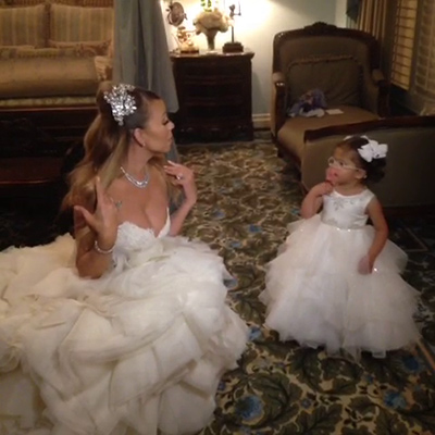 Mariah Carey and daughter Monroe, wearing wedding attire, prepare for the singer&#39;s wedding vow renewal ceremony to husband Nick Cannon at Disneyland on April 30, 2013, as seen in a Vine video she posted. Accompanied by Monroe and twin son Moroccan, Carey and Cannon renewed their vows that day to celebrate their fifth anniversary as well as the children&#39;s second birthday.  &#39;Mommy and Princess Monroe,&#39; Carey Tweeted. <span class=meta>(vine.co&#47;v&#47;bQBEtM6OI7w)</span>