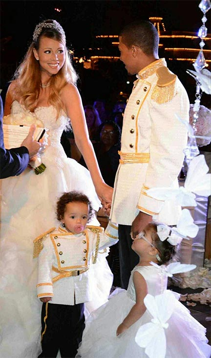 Mariah Carey and Nick Cannon are seen in wedding attire at Disneyland on April 30, 2013. Accompanied by their twins Moroccan and Monroe, the two renewed their vows that day to celebrate their fifth anniversary.