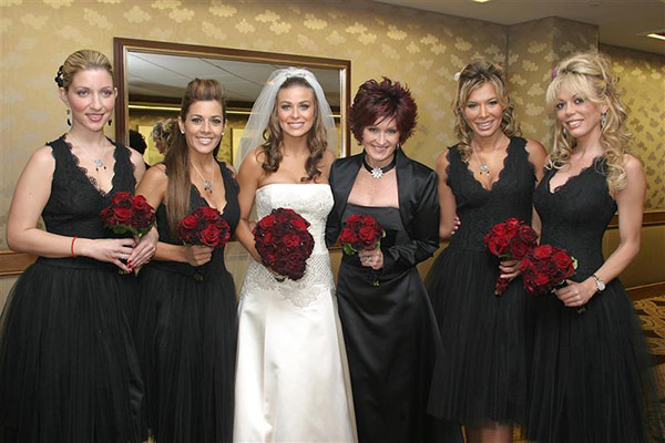 Carmen Electra married rocker Dave Navarro om Nov. 22, 2003 at the St. Regis hotel in Los Angeles. She is pictured here with her bridesmaids and guest Sharon Osbourne. Electra wore a Badgley Mischka wedding gown. She and Navarro divorced in 2007. They have no children together. <span class=meta>(Simon &#47; Ferreira &#47; Startraksphoto.com)</span>
