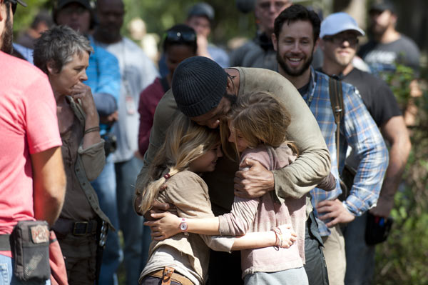 Melissa McBride &#40;Carol Peletier&#41;, Kyla Kenedy &#40;Mika&#41;, Brighton Sharbino &#40;Lizzie&#41;, Chad L. Coleman &#40;Tyreese&#41; and crew members appear on the set of AMC&#39;s &#39;The Walking Dead&#39; episode 14, &#39;The Grove,&#39; which aired on March 16, 2014. <span class=meta>(Gene Page &#47; AMC)</span>
