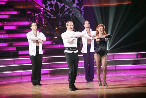 "<div class=""meta image-caption""><div class=""origin-logo origin-image ""><span></span></div><span class=""caption-text"">Carson Kressley returned to the ballroom for a final performance on 'Dancing With The Stars: The Results Show,' on Tuesday, November 22, 2011. He appears with show partner Anna Trebunskaya and male dancers Ted Volynets and Val Chermokskiy. (ABC / Adam Taylor)</span></div>"