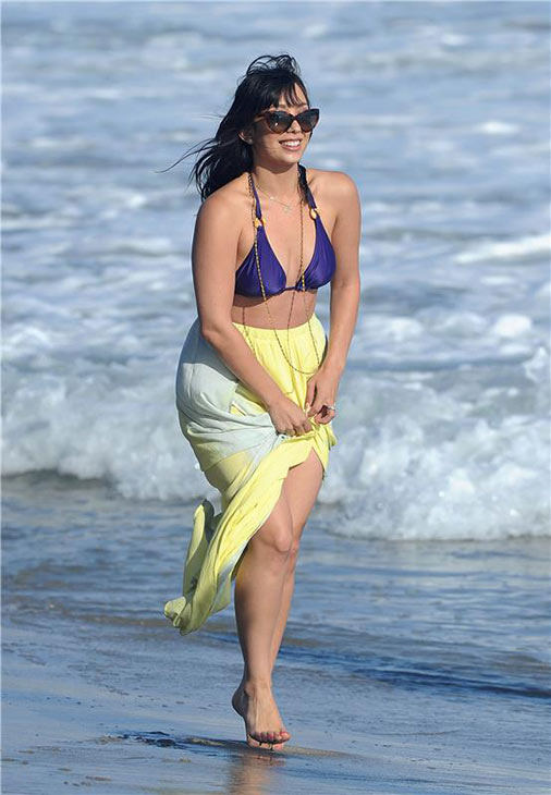 Cheryl Burke walks on the beach in a bikini near the Voli Light Beach House, where she hosted a party, on July 13, 2013.