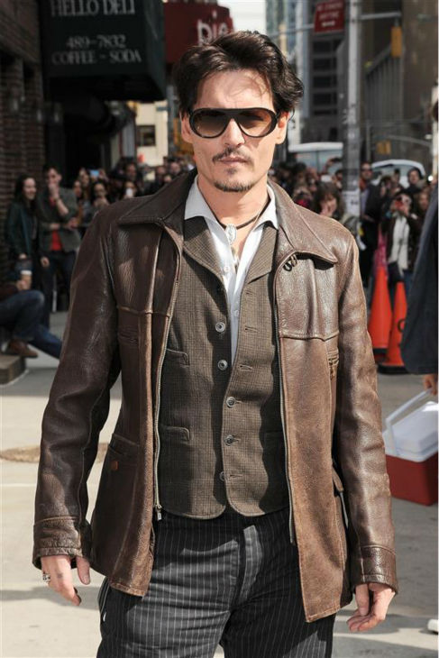 Johnny Depp, wearing a brown jacket and the engagement ring he initially gave fiancee Amber Heard -- a &#39;chick&#39;s ring&#39; -- arrives to a taping of &#39;The Late Show with David Letterman&#39; in New York on April 3, 2014. <span class=meta>(Bill Davila &#47; Startraksphoto.com)</span>