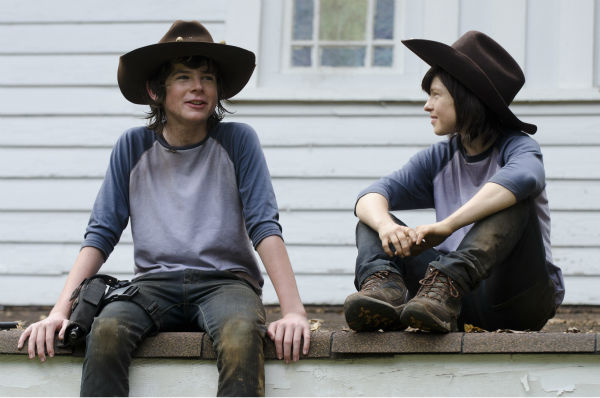 "<div class=""meta ""><span class=""caption-text "">Chandler Riggs (Carl Grimes) and his body double appear on the set of AMC's 'The Walking Dead's season 4 midseason premiere, titled 'After,' which aired on Feb. 9, 2014. (Gene Page / AMC)</span></div>"