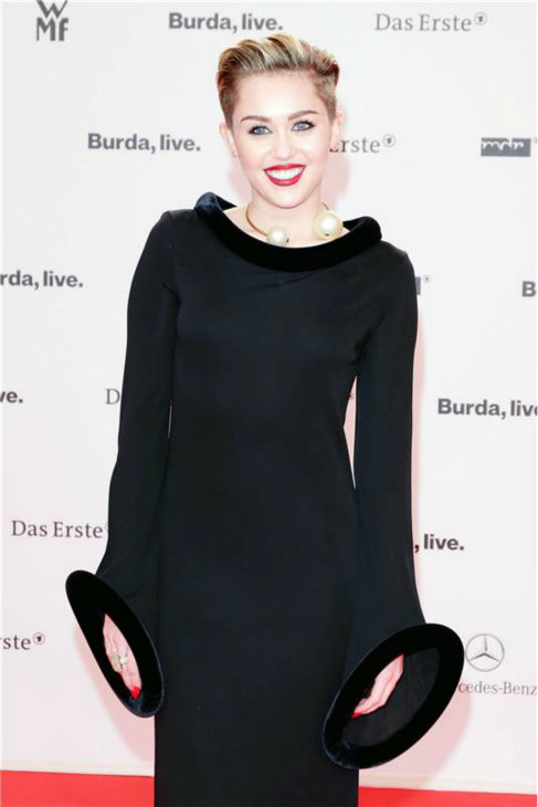 Miley Cyrus, wearing a vintage Jean Paul Gaultier gown, appears at the 2013 BAMBI German Media Awards at the Stage Theater in Berlin on Nov. 14, 2013.