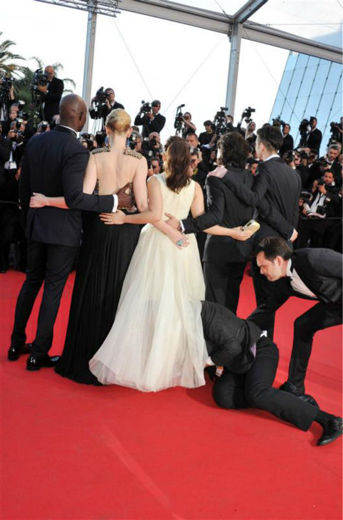 A security official tries to restrain notorious prankster of celebrities, Ukrainian reporter Vitalii Sediuk, after he crawled under actress America Ferrera&#39;s ball gown at a screening of &#39;How To Train Your Dragon 2&#39; at the 2014 Cannes Film Festival on Friday, May 16, 2014. Also pictured: Kit Harington. <span class=meta>(Camilla Morand &#47; IPA &#47; Startraksphoto.com)</span>