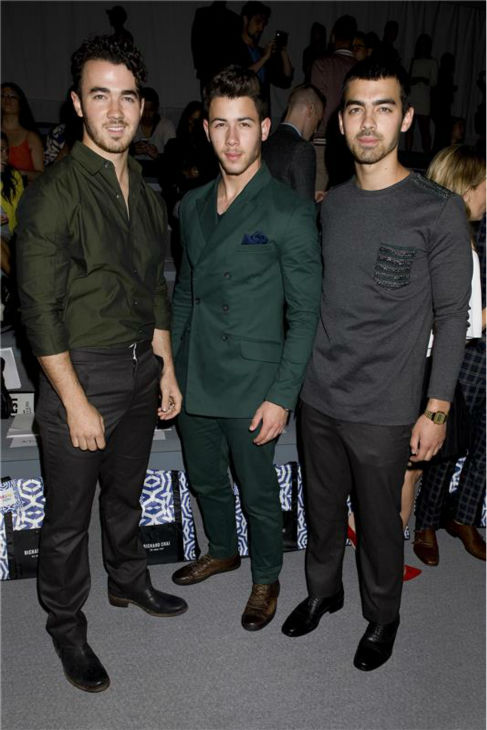 Jonas Brothers members Kevin, Nick and Joe Jonas appear at Richard Chai&#39;s fashion show at Lincoln Center in New York, part of the Spring 2014 Mercedes-Benz Fashion Week, on Sept. 5, 2013. <span class=meta>(Justin Campbell &#47; Startraksphoto.com)</span>