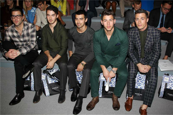 Zachary Quinto, Jonas Brothers members Kevin, Joe and Nick Jonas and 'Teen Wolf' actor Colton Haynes sit together at Richard Chai's fashion show at Lincoln Center in New York, part of the Spring 2014 Mercedes-Benz Fashion Week, on Sept. 5, 2013.