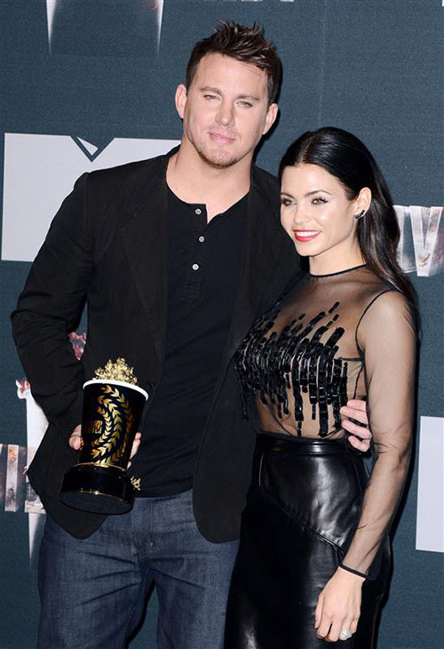 Channing Tatum and wife Jenna Dewan-Tatum appear backstage at the 2014 MTV Movie Awards at the Nokia Theatre in Los Angeles on April 13, 2014. Channing won the Trailblazer award. <span class=meta>(Lionel Hahn &#47; AbacaUSA &#47; Startraksphoto.com)</span>