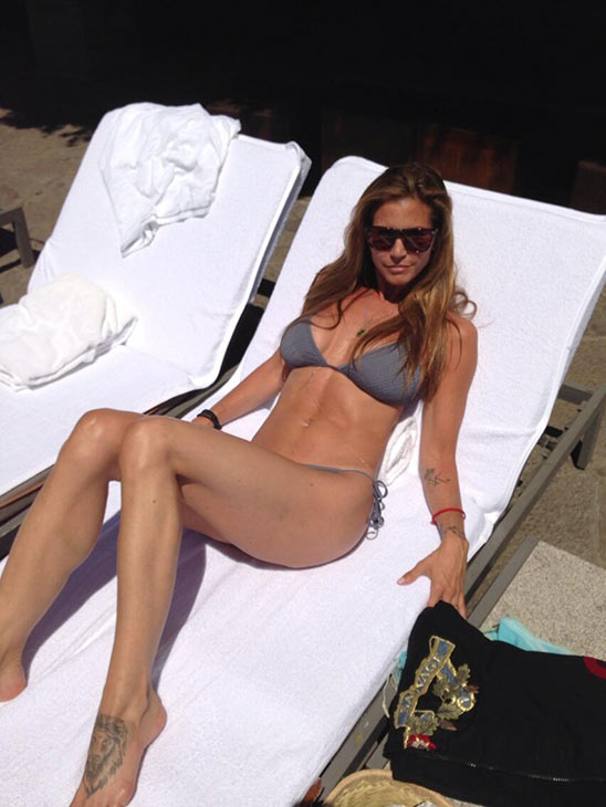 Charisma Carpenter of 'Buffy The Vampire Slayer' fame tweeted this photo of herself tanning in a bikini on Aug. 22, 2013.