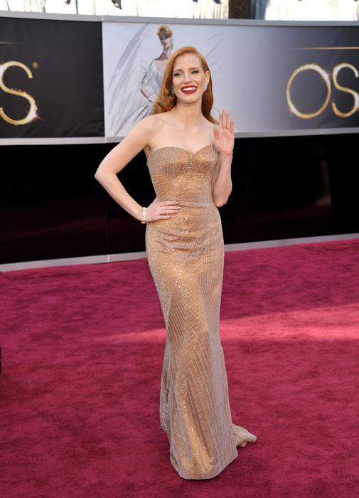 "<div class=""meta image-caption""><div class=""origin-logo origin-image ""><span></span></div><span class=""caption-text"">Jessica Chastain arrives at the 85th Academy Awards at the Dolby Theatre on Sunday Feb. 24, 2013, in Los Angeles. Chastain wore a nude metallic Armani Privé gown with an all-over subtle geometric print to the event. (AP Photo/John Shearer/Invision)</span></div>"