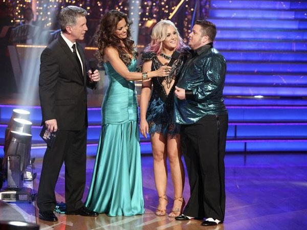 Chaz Bono, partner Lacey Schwimmer and co-hosts Tom Bergeron and Brooke Burke appear on the finale of 'Dancing With The Stars' 13th season' on Tuesday, November 22, 2011.