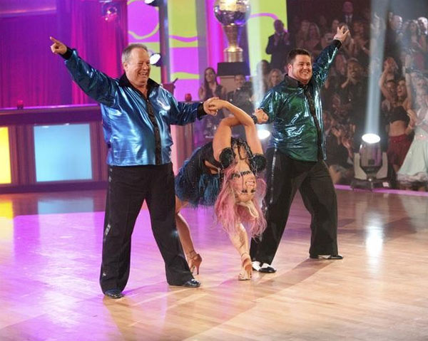 "<div class=""meta ""><span class=""caption-text "">Chaz Bono returned to the ballroom for a final performance on 'Dancing With The Stars: The Results Show,' on Tuesday, November 22, 2011. He appears here with show partner Lacey Schwimmer and her father, Buddy Schwimmer, who is also a dancer and a famous choreographer. (ABC / Adam Taylor)</span></div>"