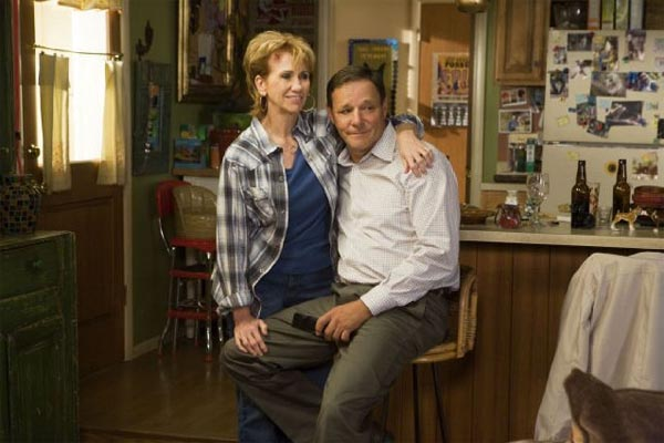 Pictured: Chris Mulkey (right) and Kathy Baker (left) in a scene from the TV show, 'Saving Grace.'