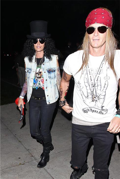 Supermodel Cindy Crawford appears as Slash and husband Rande Gerber dresses up as Guns N&#39; Roses singer Axl Rose for a Halloween party in Beverly Hills, California on Oct. 25, 2013. <span class=meta>(David Wright &#47; Startraksphoto.com)</span>