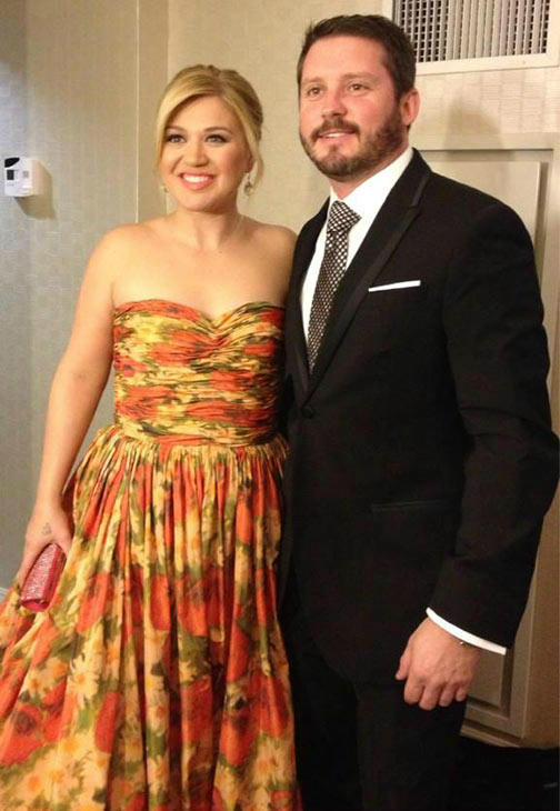 &#39;Me and Brandon in our &#39;fancy&#39; attire :&#41; Fun night!&#39; Tweeted Kelly Clarkson, who wore this strapless Oscar de la Renta floral gown to the Inaugural Ball honoring President Barack Obama on Jan. 21, 2013. She attended with her fiance, Brandon Blackstock. <span class=meta>(pic.twitter.com&#47;6cl1lo4G &#47; twitter.com&#47;kelly_clarkson)</span>