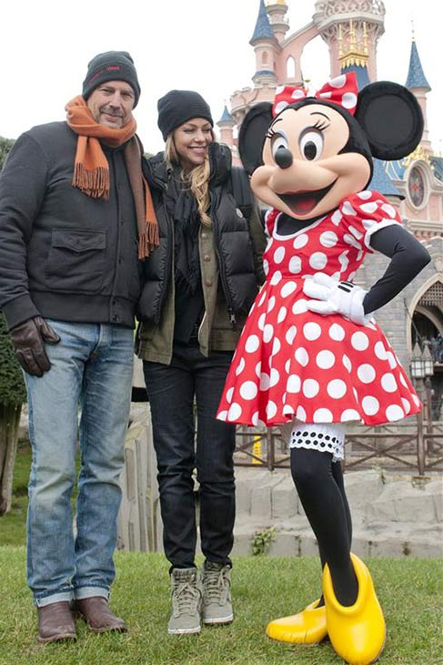 Kevin Costner and wife Christine Baumgartner pose with Minnie Mouse at Disneyland Paris on Feb. 3, 2013. They visited the park with their three children.