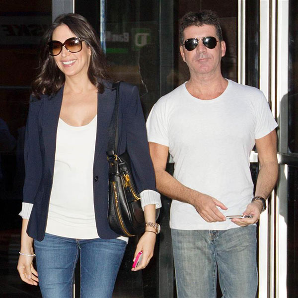 Simon Cowell, former &#39;American Idol&#39; and &#39;The X Factor USA&#39; judge, appears with pregnant girlfriend Lauren Silverman in New York on Sept. 19, 2013. The two welcomed a baby boy -- his first child -- on Feb. 14, 2014 -- Valentine&#39;s Day. <span class=meta>(Freddie Baez &#47; Startraksphoto.com)</span>