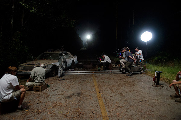 "<div class=""meta ""><span class=""caption-text "">A film crew films a scene, in which Daryl (Norman Reedus, not pictured) and Beth (Emily Kinney, not pictured) take refuge in the trunk of an abandoned car to hide from Walkers, on the set of AMC's 'The Walking Dead' episode 12, 'Still,' which aired on March 2, 2014. (Gene Page / AMC)</span></div>"