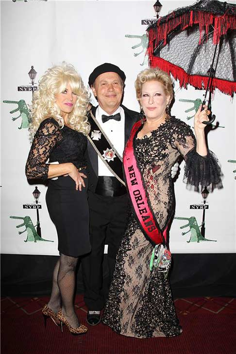 Katie Couric, Billy Crystal and Bette Midler appear in their Halloween costumes at Midler's New York Restoration Project's annual 'Hulaween in the Big Easy' at the Waldorf Astoria in New York on Oct. 31, 2013.