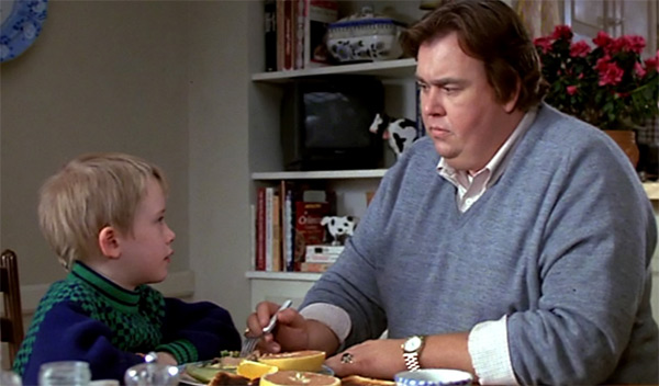 Macaulay Culkin and John Candy appear in a scene...